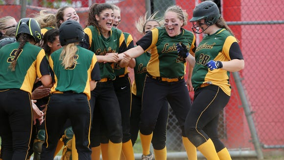 From right, Lakeland's Claire Fon (28) is greeted by