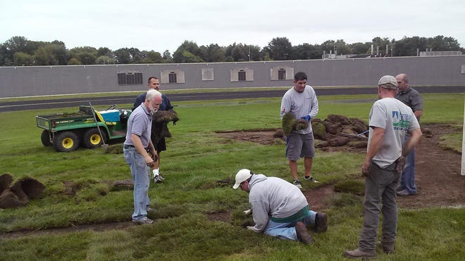 Crews replace damaged field at Bedford High School. Weed killer was used to leave a 100-yard depiction of male genitalia on a Monroe County high school football field.
