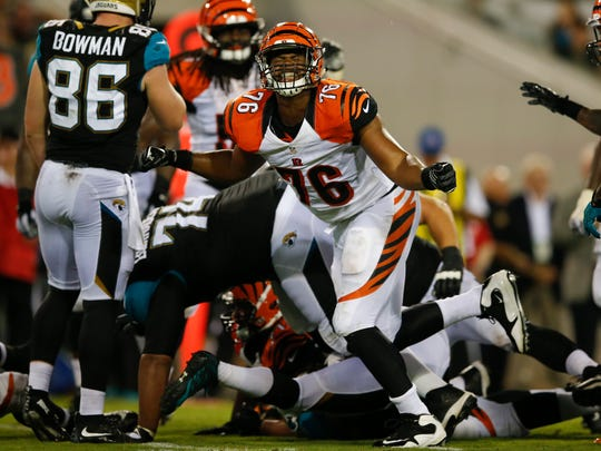 Bengals defensive end Ryan Brown reacts after making