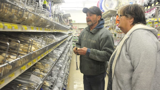 Wayne and Deb Mitchell search through a few pipe fittings Friday at the Bucyrus True Value.