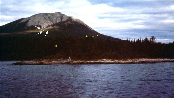 Earthquake lights are a rare phenomenon resulting from specific geological conditions. Rocks subjected to great stress produce electrical charges that can be channeled to the surface through deep vertical faults. Earthquake lights shine near Tagish Lake in Canada's Yukon territory.