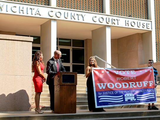 Robert Woodruff (second from left) announces his candidacy