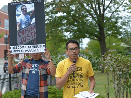 Abel Luna, an organizer with Migrant Justice, speaks to demonstrators assembled Saturday afternoon in front of the First Unitarian Church at the top of Church Street in Burlington. More than 100 people marched to protest the detention by immigration authorities of immigrant farm worker and activist Miguel Alcudia in September.