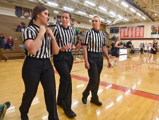 Officials Amanda Tate, Haley Johnson and Sandy Engdahl