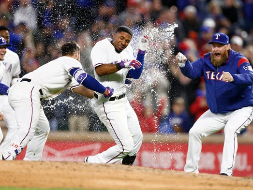Texas Rangers shortstop Elvis Andrus (middle) is chased