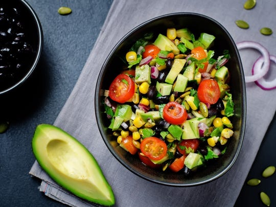 A black bean, corn and avocado salad can become just one of many go-to meals for those dog days of summer, when you'd rather not heat up with stove or oven