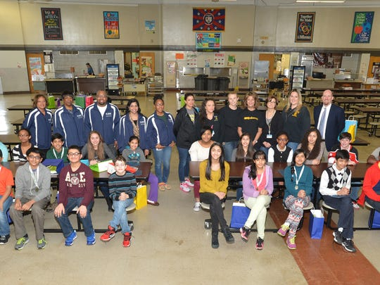 Students from Avenel Middle School qualified to participate in the Chemical Education Foundation's You Be The Chemist MIddlesex County local Challenge. This group photo shows all the students who competed, along with teachers, scientists from BASF, and Principal Joseph Short.