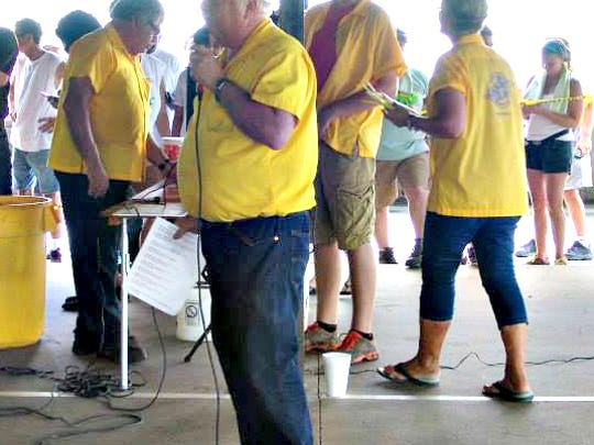 Rick Bonenberger making announcements during the annual Frog Follies Frog Race.