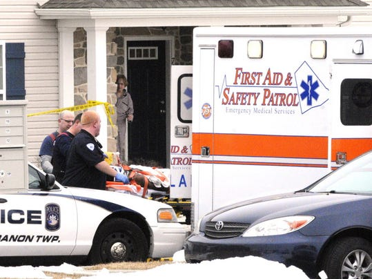 Medics place a man into an ambulance after he was shot in a drug-related shooting at Fox Ridge apartments in South Lebanon Township on March 10, 2014.