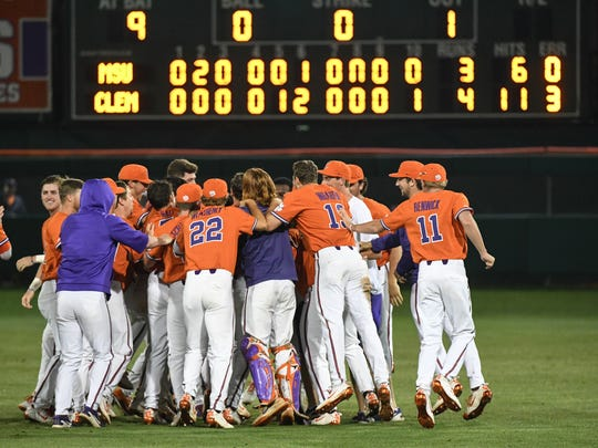 Clemson celebrates after winning in the bottom of the tenth inning against Morehead State 4-3 early Saturday morning June 2, 2018.