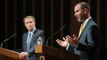 Joe Hogsett, Democrat, and Chuck Brewer, Republican, squared of in a mayoral forum on Sept. 10, 2015, at the Indiana Landmark Center.
