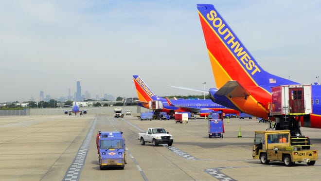 Southwest airlines planes on the tarmac at Chicago's Midway Airport in Chicago on Sepetmber 24, 2015.
