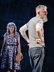Artistic Director Les Waters makes some suggestions as actress Wendy Stetson stands on stage during a rehearsal in the production At The Vanishing Point by playwright Naomi Iizuka. At left is actor Bruce McKenzie, who plays a photographer who is loosely based on Meatyard. The play takes place in the Butchertown neighborhood. By Matt Stone, The Courier-Journal Jan. 24, 2015