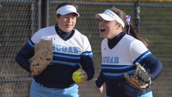 Enka junior Payton Trantham, right, had seven putouts and the game-winning hit Wednesday night against nationally-ranked North Davidson.