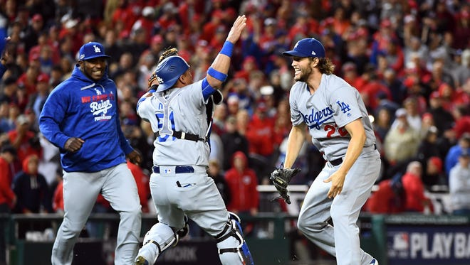 Oct 13, 2016; Washington, DC, USA; Dodgers pitcher Clayton Kershaw (22) celebrates with catcher Carlos Ruiz after winning Game 5 of the NLDS against the Washington Nationals at Nationals Park.