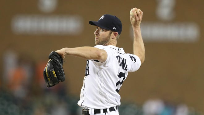 Andrew Romine pitches in the ninth inning of the Tigers' 16-2 loss to the Royals on Wednesday, July 26, 2017 at Comerica Park.