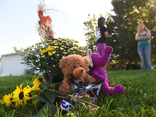 A collection of flowers, stuffed animals and candy were left at the scene along the 4800 block of South Salem Church Road in the days following the death of 13-year-old Matthew Gowen, who died after being struck by a vehicle on Thursday.