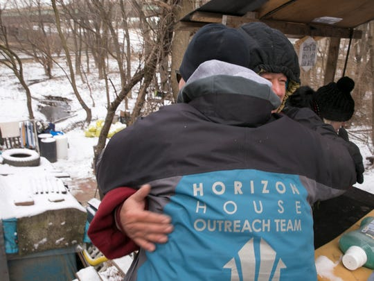 Melissa Burgess of Horizon House gets a hug from Thuan