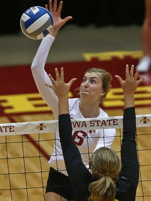 Iowa State's Alexis Conaway, left, went up high for the ball as Iowa's Mikaela Gunderson defended in the Cyclone sweep.