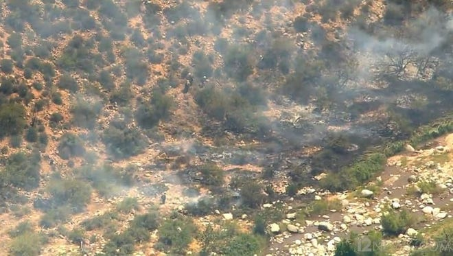 Crews were battling a small wildfire northeast of Phoenix on May 22, 2015.
