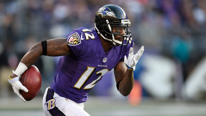 FILE - In this Nov. 30, 2014, file photo, Baltimore Ravens wide receiver Jacoby Jones carries the ball in the second half of an NFL football game against the San Diego Chargers in Baltimore. Jacoby Jones was cut Tuesday, Feb. 24, 2015, by the Baltimore Ravens. (AP Photo/Gail Burton, File)