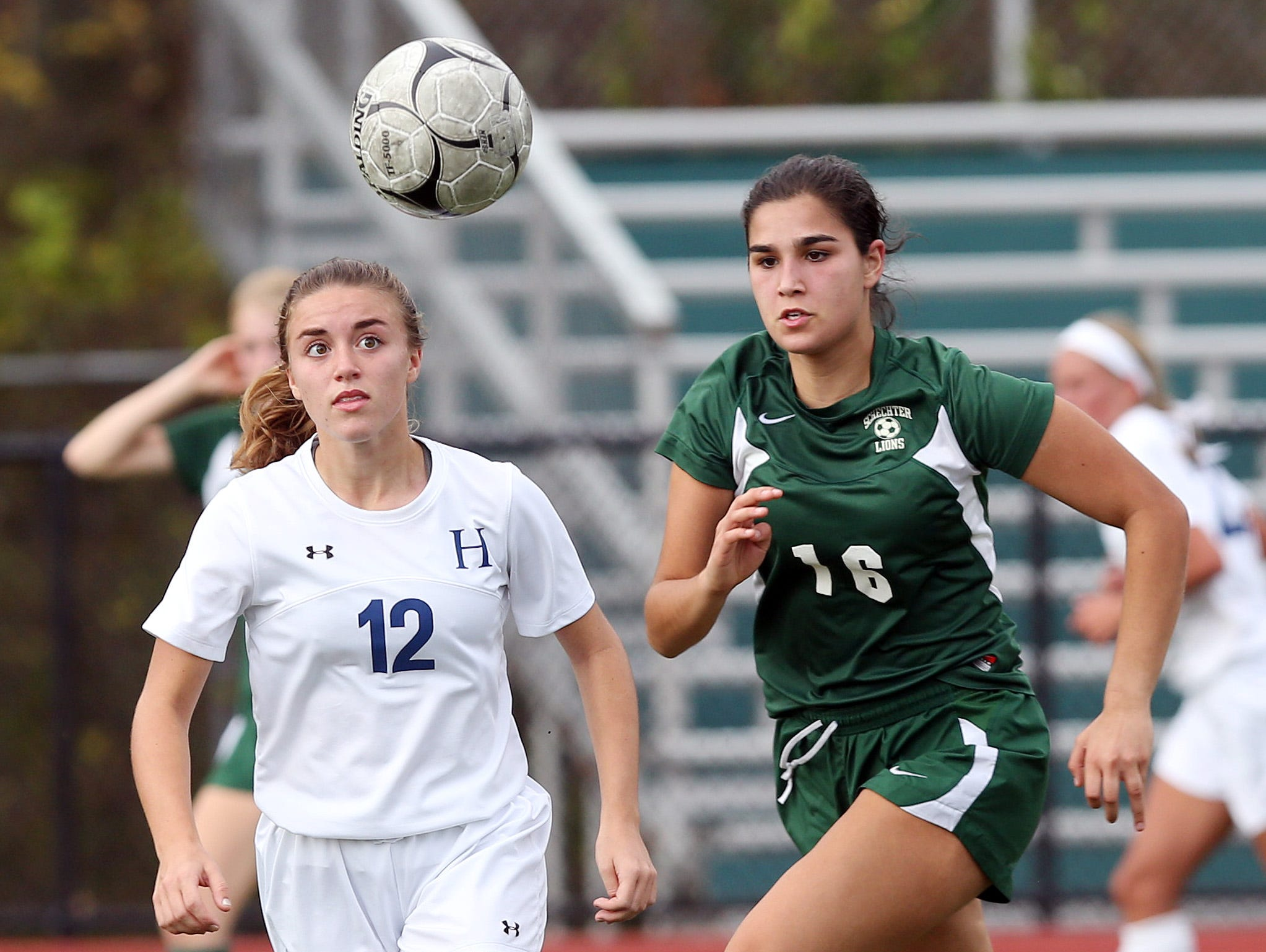 From left, Haldane's Missy Lisikatos (12) and Schechter's Eden Gilbert (16) battle for ball control during the girls soccer Section 1 Class C championship game at Yorktown High School Oct. 30, 2016. Haldane won the game 3-0.