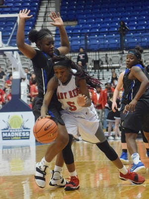 Caddo's Jadah Martin (5, right) gets past Red River's  Oksonna Williams (23, left) in the LHSAA Class 2A semifinals held Thursday, March , 2018 at the Rapides Parish Coliseum in Alexandria.