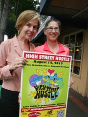 Chane Griggs, left, and Susan Gallagher want the community to know about a new fitness event designed for the entire family. The High Street Hustle 8k and 5k run/walk and kids' 1k walk will be held Aug. 15 along portions of High Street NE, which will be closed to traffic the day of the race.