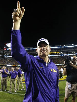 LSU coach Les Miles acknowledges the Tiger Stadium crowd before headling into he locker room for what would be his final kickoff in Baton Rouge.