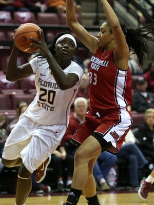 FSU's Shakayla Thomas drives past Jacksonville State's Tasha Magruder during their game at the Tucker Civic Center on Friday, Nov. 11, 2016.
