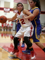 Ballinger's Bryla Perkins looks to take a shot as Reagan County's Melissa Hernandez guards her on Tuesday.