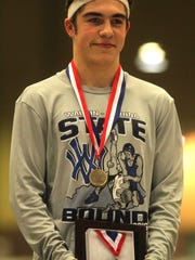 Walton-Verona junior Ryan Moore, state champion at 126, during the state finals.