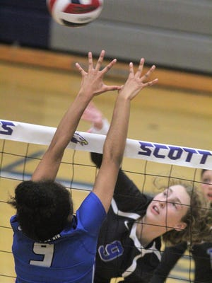 Scott senior Kelly Franxman goes for the kill against Oldham County during the Scott September Slam volleyball tournament Sept. 2, 2017 at Scott HS.