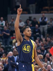 Indiana Pacers guard Glenn Robinson III (40) acknowledges the crowd as he enters a game for the first time this season against the Atlanta Hawks during the first quarter at Bankers Life Fieldhouse.