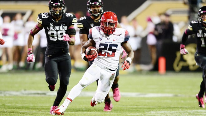 Arizona Wildcats running back Ka'Deem Carey (25) carries for thirty yards on this play in the second quarter against the Colorado Buffaloes at Folsom Field.