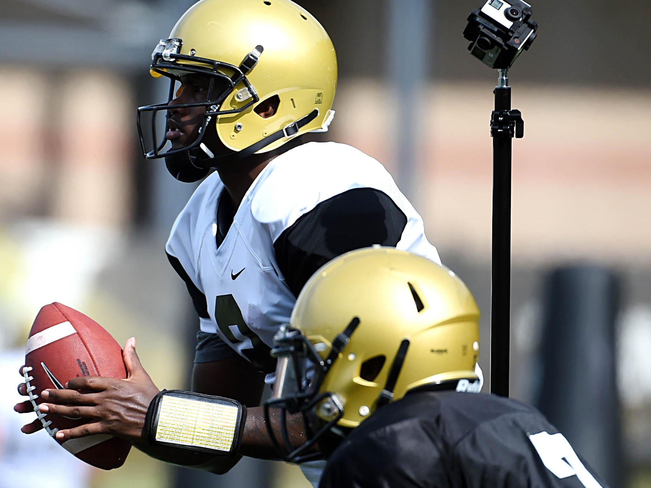 Six GoPro cameras mounted together record video of Vanderbilt quarterback Johnny McCrary (2) during practice.