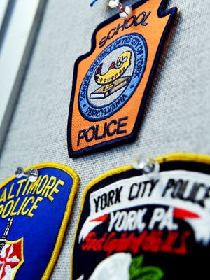 York City School Police Officer Bryan Einsig has badges for various area police departments in his office at McKinley K-8 Friday, June 8, 2018. He is working on a Public Safety and Emergency Services Program for students in the York City School District. Bill Kalina photo