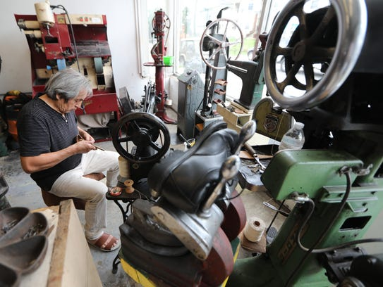 Acuna's menagerie of old machines includes a foot-pedaled