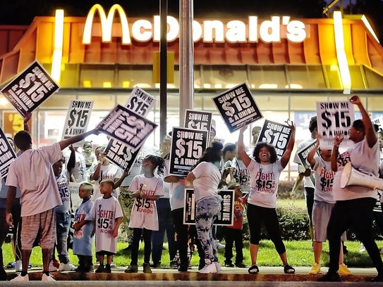 Pro-labor protesters chant outside the McDonald's on