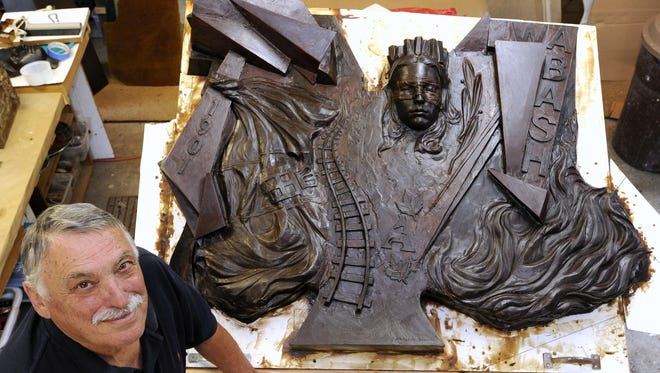 """Redford Township sculptor Sergio De Giusti, originally from Maniago, Italy, created a sculpture commemorating the victims of the """"Wreck of The Wabash."""" The work will be unveiled at Adrian's Oakwood Cemetery in September."""