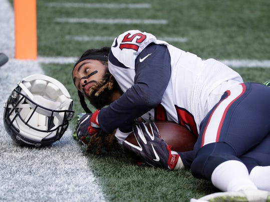 Houston Texans wide receiver Will Fuller loses his helmet after a reception for a touchdown against the Seattle Seahawks in the first half of an NFL football game, Sunday, Oct. 29, 2017, in Seattle. (AP Photo/Elaine Thompson)