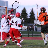 Northville's Connor Sweeney (right) takes aim at the
