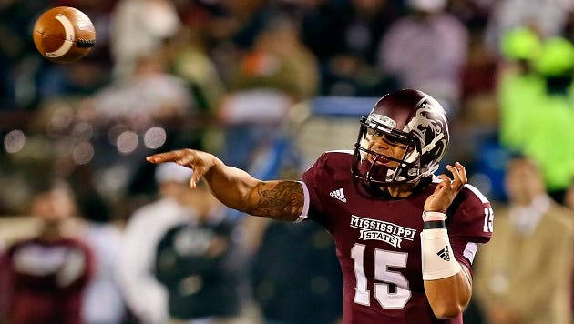 Dak Prescott (15) passes the ball during the game against the Kentucky Wildcats at Davis Wade Stadium. Mandatory Credit: Spruce Derden-USA TODAY Sports