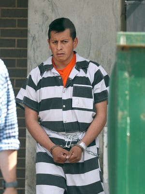Everardo Donoteo-Reyes is led from federal court where he is facing an immigration charge in June.