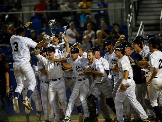 East Cobb Yankees' Xzavion Curry is greeted by teammates