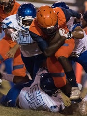 Escambia High School's Frank Peasant (No. 5) plows