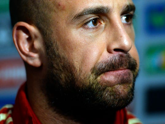 Spain's goalkeeper Pepe Reina listens to the media at the Atletico Paranaense training center in Curitiba, Brazil, Sunday, June 15, 2014. Spain will play in group B of the Brazil 2014 World Cup. (AP Photo/Manu Fernandez)