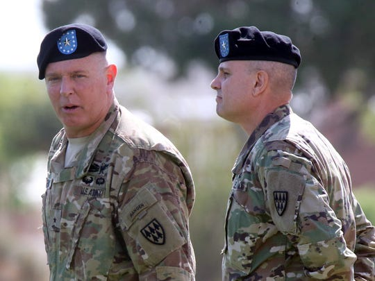 Brig. Gen. Donald G. Fryc, left, outgoing commander of the 32nd Army Air and Missile Defense Command stands with incoming commander Brig. Gen. Christopher L. Spillman Friday at Fort Bliss.