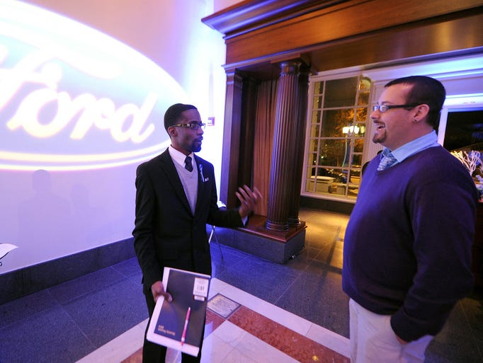 Ford Freedom Unsung honoree Ian Smith, left, of the Ian Smith Foundation, speaks with Brandon Randall during a reception, Thursday, December 12, 2013, at the Indiana Historical Society in Indianapolis. Ford Motor Company partnered with the Indianapolis Urban League to recognize winners. The winners of the awards have positively impacted communities with achievements that inform and inspire others. The Ian Smith Foundation provides tutoring and mentoring to students in need.