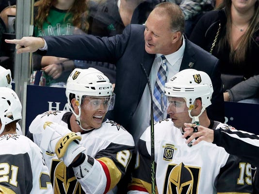 FILE - In this Oct. 6, 2017, file photo, Vegas Golden Knights coach Gerard Gallant points from the bench, behind center Jonathan Marchessault (81) and right wing Reilly Smith (19) during the third period of an NHL hockey game against the Dallas Stars in Dallas. Vegas is already the most successful first-year expansion franchise in league history and looks like a serious Stanley Cup contender as a result of shrewd moves by general manager George McPhee, the coaching of Gerard Gallant and career seasons out of several players. (AP Photo/LM Otero, File)